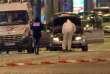 Des enquêteurs autour du véhicule du tireur qui a tué un policier et en a blessé deux autres, jeudi 20 avril sur les Champs-Elysées à Paris.