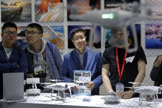 Les investisseurs (ici, un salon de la photographie et de l'imagerie professionnelle à Pékin) sont devenus moins enthousiastes à l'égard du secteur des drones.