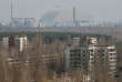 A New Safe Confinement (NSC) structure over the old sarcophagus covering the damaged fourth reactor at the Chernobyl nuclear power plant is seen from Ukraine's abandoned town of Pripyat, Ukraine, April 5, 2017. REUTERS/Gleb Garanich