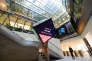 (FILES) This file photo taken on March 04, 2016 shows A woman as she walks through the central atrium at the London Stock Exchange in central London on March 4, 2016. The EU blocked the blockbuster merger of the London Stock Exchange with Germany's Deutsche Boerse on March 29, 2017, snagged by competition concerns and the fallout from Brexit. / AFP PHOTO / LEON NEAL