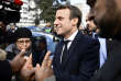 Emmanuel Macron (C), head of the political movement En Marche !, or Onwards !, and candidate for the 2017 presidential election, speaks with residents during a campaign visit in Sarcelles, near Paris, April 27, 2017.  REUTERS/Martin Bureau/Pool