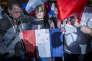 Une supportrice arbore son soutien à Marine Le Pen lors du meeting électoral d'Emmanuel Macron à Arras le 26 avril?