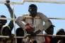 Des migrants à bord du navire de commerce « Tuna 1 », à leur arrivée à Palerme, le 18 avril, après avoir été secourus au large des côtes libyennes.