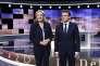 Emmanuel Macron et Marine Le Pen sur le plateau de TF1 avant le débat d'entre-deux-tours de l'élection présidentielle le 3 mai.