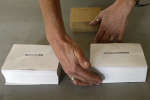 An worker places the ballots on a table at a polling station at the town hall of Bayonne, southwestern France, Friday, May 5, 2017. France will vote on Sunday May 7 in the second round of the presidential election. (AP Photo/Bob Edme)