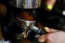 A barista prepares coffee at Moko cafe in Warsaw, Poland May 7, 2017. REUTERS/Kacper Pempel