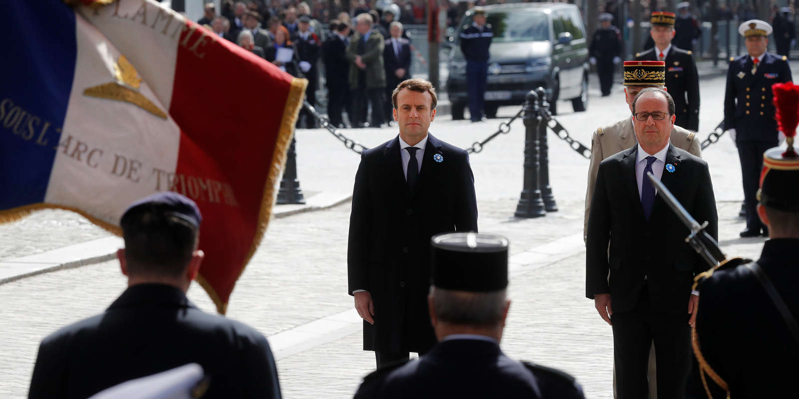 Outgoing French President Francois Hollande (R) and President-elect Emmanuel Macron attend attend a ceremony to mark the end of World War II at the Tomb of the Unknown Soldier at the Arc de Triomphe in Paris, France, May 8, 2017. REUTERS/Philippe Wojazer