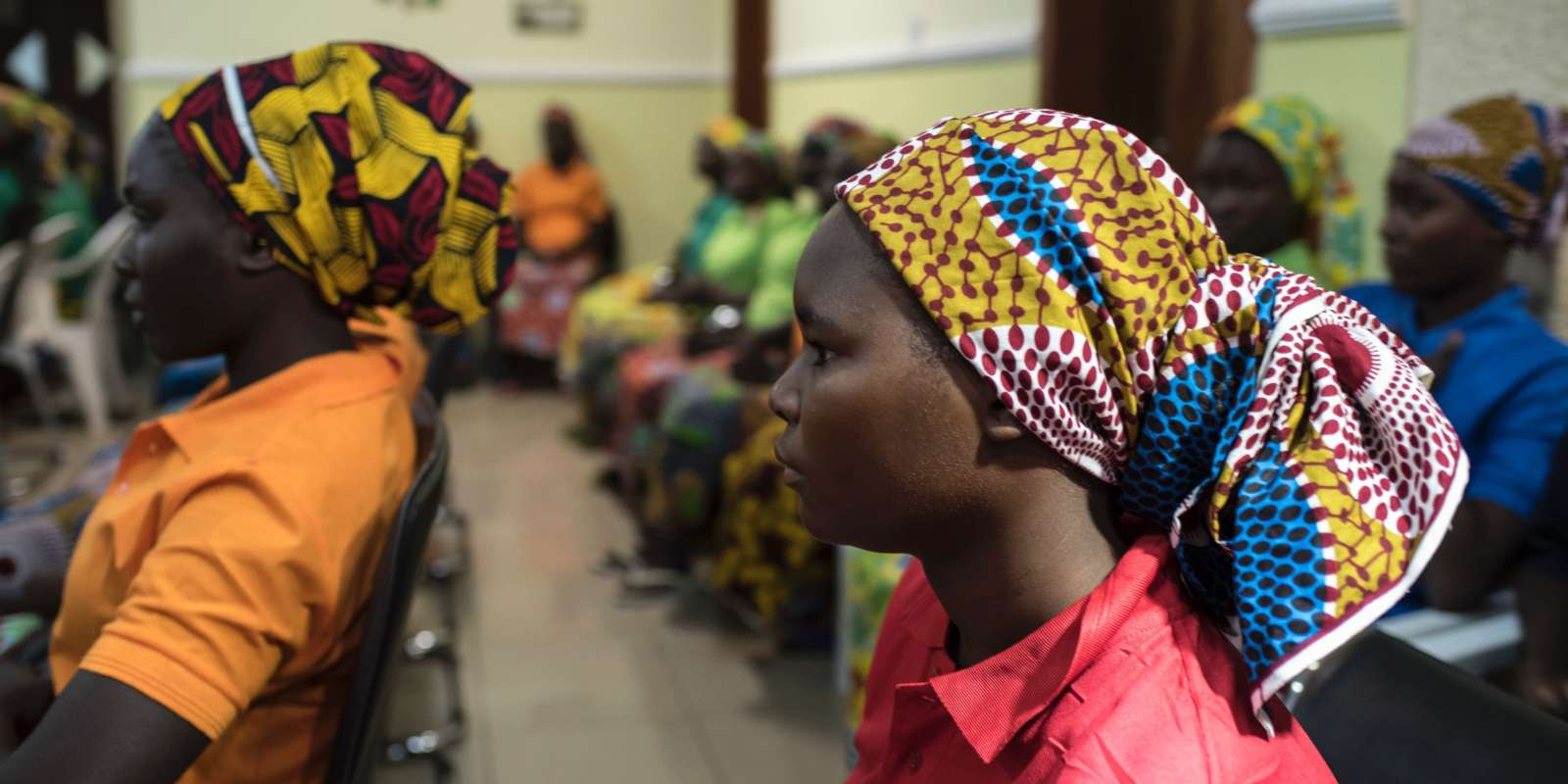 Some of the recently released girls from Chibok wait in Abuja on May 8, 2017. The United Nations on May 8, 2017 welcomed the release of 82 Nigerian schoolgirls after years of Boko Haram captivity and appealed to their families and communities not to ostracize them. The teenage girls who were among more than 200 kidnapped in 2014 from the Government Girls Secondary School in Chibok, northeast Nigeria, northeast Nigeria, were freed on May 6, 2017 after a prisoner swap agreed with the Islamist group. / AFP / STEFAN HEUNIS