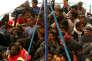 Des migrants venus de Libye et secourus en mer arrivent àCatane, en Sicile, le 6mai.
