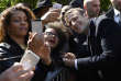 President-elect Emmanuel Macron, right, poses for a picture with supporters after a ceremony to mark the anniversary of the abolition of slavery, Wednesday May 10, 2017 in Paris. (Eric Feferberg, Pool via AP)