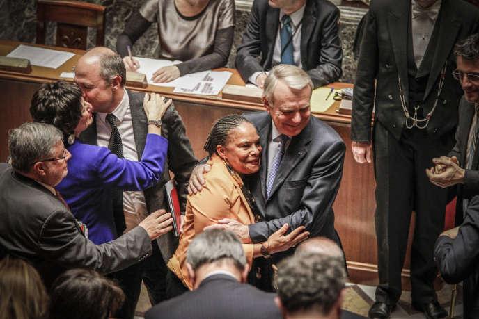 Christiane Taubira et Jean-Marc Ayrault lors de l'adoption de la loi sur le mariage pour tous, à l'Assemblée, le 3 avril 2013.
