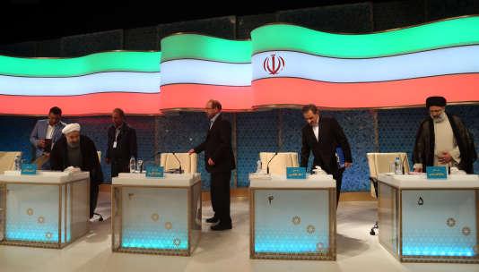 Hassan Rohani, Mohammad Bagher Ghalibaf, Eshagh Jahangiri et Ebrahim Raisi lors du débat télévisé du 28 avril à Téhéran .