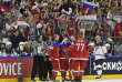 Russia's forward Nikita Gusev, center, is celebrated after scoring the opening goal during the Ice Hockey World Championships group A match between Russia and USA at the LANXESS arena in Cologne, Germany, Tuesday, May 16, 2017. (AP Photo/Martin Meissner)