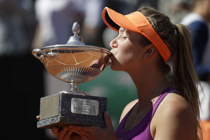 Ukraine's Elina Svitolina kisses the trophy after winning during her final match against Romania's Simona Halep at the Italian Open tennis tournament, in Rome, Sunday, May 21, 2017. (AP Photo/Gregorio Borgia)