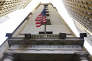 FILE - In this Friday, Nov. 13, 2015, file photo, the American flag flies above the Wall Street entrance to the New York Stock Exchange. U.S. stocks are broadly higher early Monday, May 22, 2017, as the market bounces back from a turbulent week. Defense contractors are making some of the largest gains and materials makers, technology and consumer-focused companies are all rising. Ford is up after it replaced CEO Mark Fields, while chemicals maker Huntsman is rising after it agreed to combine with Swiss competitor Clariant. (AP Photo/Richard Drew, File)