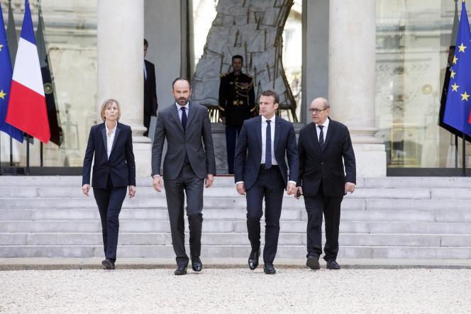 Marielle de Sarnez, Edouard Philippe, Emmanuel Macron et Jean-Yves Le Drian, à l'Elysée, le 23 mai.
