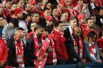 Liverpool fans observe a minute's silence for victims of the Manchester terror attack before their end-of-season friendly football match against Sydney FC at the Olympic Stadium in Sydney on May 24, 2017. IMAGE RESTRICTED TO EDITORIAL USE - STRICTLY NO COMMERCIAL USE