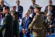 Donald Trump, assis aux côtés de la première ministre britannique Theresa May, lors de la cérémonie au siège de l'OTAN, à Bruxelles, jeudi 25 mai.