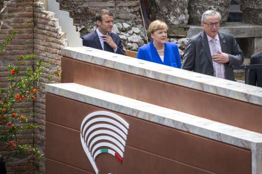 Emmanuel Macron, Angela Merkel et Jean-Claude Junker le 26 mai.