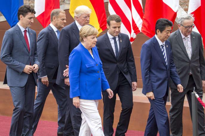Justin Trudeau, Donald Tusk, Donald Trump, Angela Merkel,Emmanuel Macron, Shinzo Abeet Jean-Claude Junker, au sommet du G7 le 26 mai.