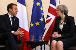 Britain's Prime Minister Theresa May and French President Emmanuel Macron talk during a bilateral meeting at the Summit of the Heads of State and of Government of the G7, the group of most industrialized economies, plus the European Union, on May 26, 2017 in Taormina, Sicily. The leaders of Britain, Canada, France, Germany, Japan, the US and Italy will be joined by representatives of the European Union and the International Monetary Fund (IMF) as well as teams from Ethiopia, Kenya, Niger, Nigeria and Tunisia during the summit from May 26 to 27, 2017. / AFP / POOL / Dan Kitwood