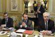 Emmanuel Macron entouré par Alexis Kohler (à gauche) et Bernard Rogel, à l'Elysée, le 24 mai.