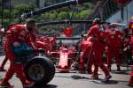 TOPSHOT - Ferrari's Finnish driver Kimi Raikkonen arrives in the pits during the third practice session at the Monaco street circuit, on May 27, 2017 in Monaco, on the eve of the Monaco Formula 1 Grand Prix.  / AFP / BERTRAND LANGLOIS