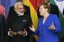 «Une certaine idée de l'Inde, qui a dominé ces soixante-dix dernières années, est en train de mourir sans que l'Europe s'en émeuve».(Photo : Le premier ministre indien Narendra Modi rencontre la chancelière allemande Angela Merkel lors de la première étape de sa tournée européenne. A Berlin, le mardi 30mai).