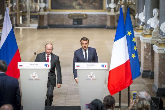 Emmanuel Macron et Vladimir Poutine, au château de Versailles, le 29 mai.