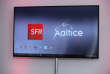 A photo shows the logos of the French telecommunications company SFR and telecommmunications and media group Altice during a SFR press conference in Paris on January 23, 2017 / AFP PHOTO / ERIC PIERMONT