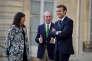 La maire de Paris Anne Hidalgo, l'ancien maire de New York Michael Bloomberg et le président Emmanuel Macron à l'Elysée le 2 juin.