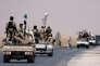 Des soldats des Forces démocratiques syriennes se dirigent versRakka (nord de la Syrie), le 6 juin.
