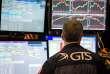«Les collectivités locales ont en effet calculé leur plan de financement des retraites en tablant sur des taux de rendement de 7 % à 8 %, soit plus du double de la réalité» (Photo: un trader, New York Stock Exchange, le 8 juin).