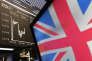 A British flag appears on a TV screen with the curve of the German stock index DAX in the background at the stock market in Frankfurt, Germany, Friday, June 9, 2017, the day after the British elections. (AP Photo/Michael Probst)
