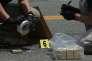 Des employés du FBI à la recherche d'indices sur le site de la fusillade au stade Eugene Simpson, à Alexandria en Virginie, le 14 juin.