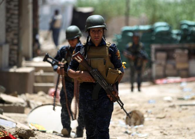 Des hommesdes forces antiterroristes irakiennes, à Mossoul, le 18 juin 2017.