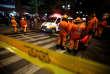 Des services de secours devant le centre commercial Andino, à Bogota, après une explosion le 17 juin.