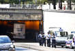 French police officers block the area after a bus hit the roof of a Paris tunnel, Friday, June 23, 2017 . A tour bus company says one of its double-decker, open-roof buses hit the roof of a Paris tunnel, injuring four people, one of them seriously. (AP Photo/Thibault Camus)
