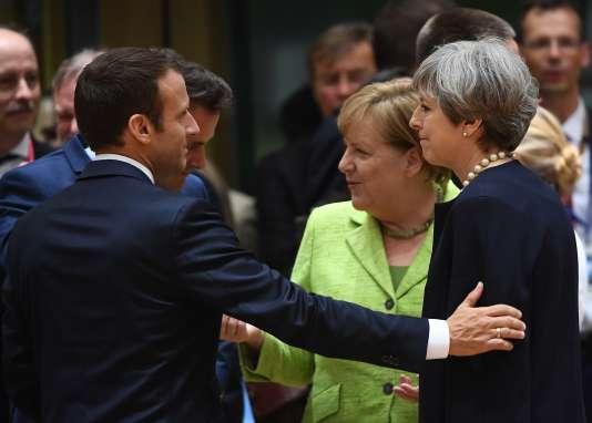 Emmanuel Macron, Angela Merkel et Theresa May, au cours du sommet européen de Bruxelles, le 22 juin 2017.