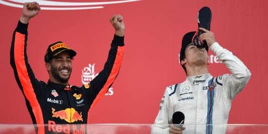Qui est le plus heureux de l'Australien Daniel Ricciardo, à gauche, victorieux du cinquième Grand Prix de sa carrière, ou du Canadien Lance Stroll, qui monte sur son premier podium à seulement 18 ans ?