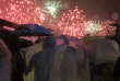 A couple braves heavy rain to watch fireworks set off to mark the 20th anniversary of the Hong Kong handover to China in Hong Kong, Saturday, July 1, 2017. (AP Photo/Ng Han Guan)