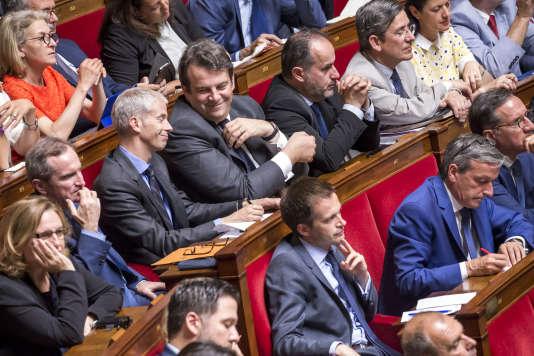 Franck Riester, Thierry Solère et le groupe Les Constructifs écoutent le premier ministre, Edouard Philippe, prononcer son discours de politique générale à l'Assemblée nationale, à Paris, le 4 juillet.