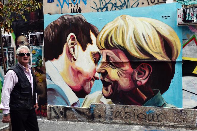 Graffiti de l'artiste de rue Jupiterfab, représentant le premier ministre grec Alexis Tsipras et la chancelière allemande Angela Merkel, le 16 octobre 2015, à Athènes.