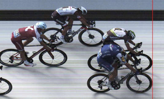 In this photo finish image released on Friday July 7, 2017 by A.S.O., Germany's sprinter Marcel Kittel, bottom right, crosses the finish line ahead of Norway's Edvald Boasson Hagen, top right, Australia's Michael Matthews, top center, and Norway's Alexander Kristoff, left, to win the seventh stage of the Tour de France cycling race over 213.5 kilometers (132.7 miles) with start in Troyes and finish in Nuits-Saint-Georges, France. (A.S.O via AP)