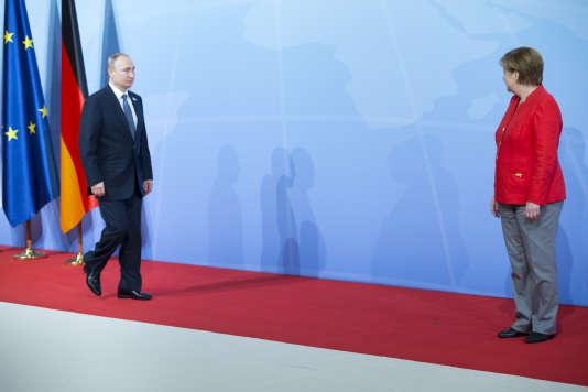 Vladimir Poutine et Angela Merkel participent à la réunion des chefs d'Etat et de gouvernement des pays membres du groupe du G20 à Hambourg, Allemagne, vendredi 7 juillet 2017 - 2017©Jean-Claude Coutausse / french-politics pour Le Monde