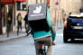 FILE PHOTO: A cyclist rides a bicyle as he delivers food for Deliveroo, an example of the emergence of what is known as the 'gig economy', in Paris, France, April 7, 2017. Picture taken April 7, 2017. REUTERS/Charles Platiau/File Photo