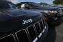 MIAMI, FL - APRIL 22: 2015 Jeep Grand Cherokee vehicles are seen on a sales lot as Fiat Chrysler Automobiles announced that it is recalling more than 1.1 million cars and SUVs worldwide because the vehicles may roll away after drivers exit the vehicles on April 22, 2016 in Miami, Florida. The recall covers the 2012-2014 Dodge Charger and Chrysler 300 sedans and 2014-2015 Jeep Grand Cherokee sport utility vehicles. Joe Raedle/Getty Images/AFP