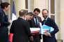 Edouard Philippe, premier ministre et Gérald Darmanin, ministre de l'action et des comptes publics (au centre) quittent l'Elysée, le 11 juillet.