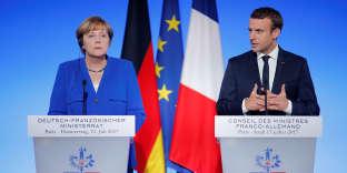 Le président Emmanuel Macron et la chancelière allemande Angela Merkel lors d'un conseil des ministres franco-allemand à Paris, le 13 juillet.