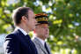 French President Emmanuel Macron (L) and Chief of the Defence Staff, French Army General Pierre de Villiers arrive for the annual Bastille Day military parade on the Champs-Elysees in Paris, France, July 14, 2017. REUTERS/Etienne Laurent/Pool